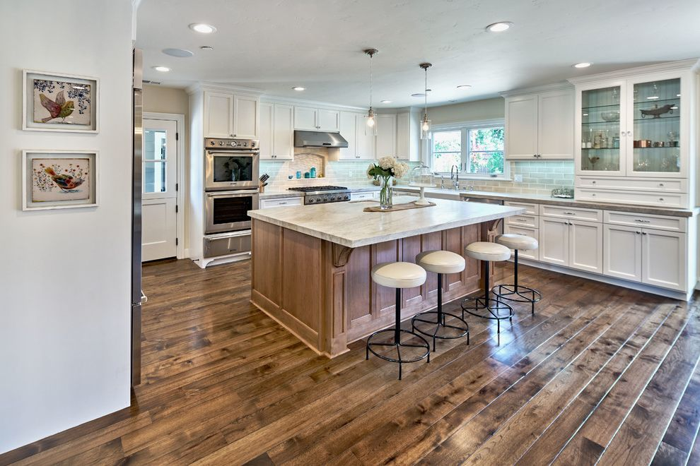 Blakely Flooring with Traditional Kitchen Also Crown Molding Framed Wall Art Glass Front Cabinets Great Room Ranch Style Home Remodel Ranch Styles Homes Recessed Lighting Traditional Kitchen White Barstools White Cabinet White Kitchen