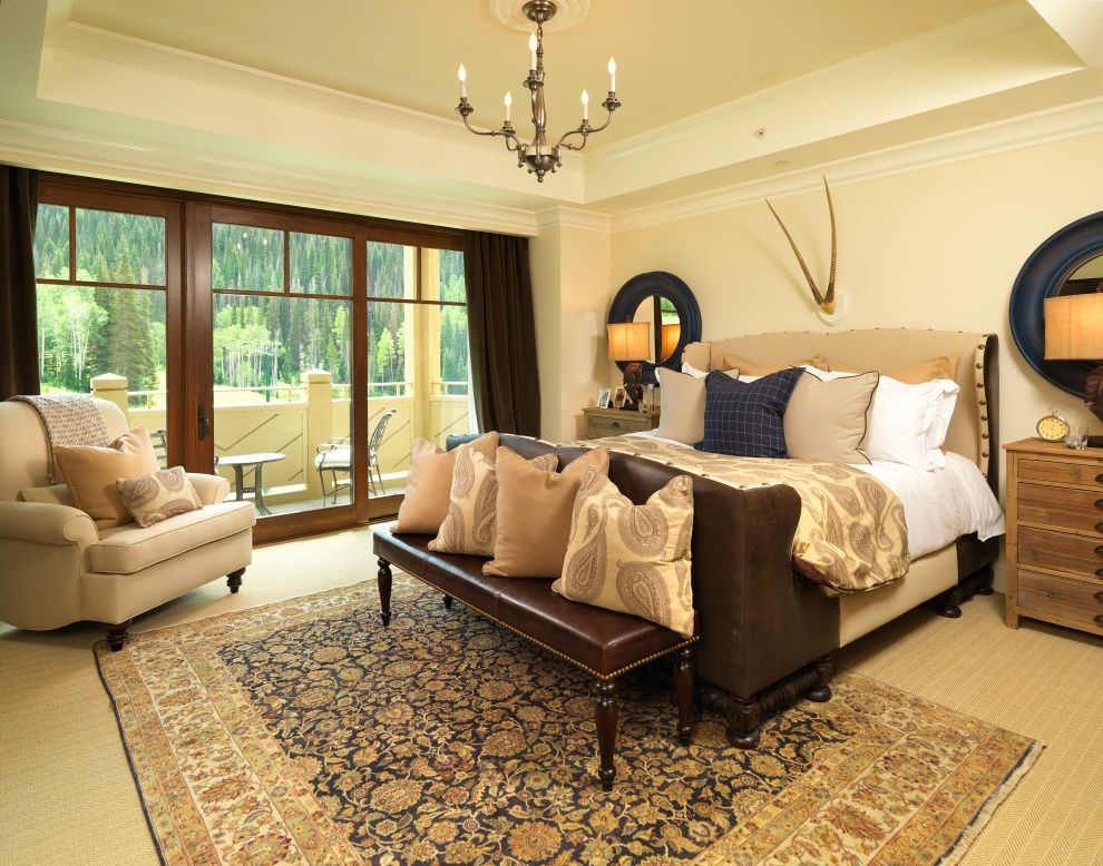 Blue and Tan Area Rugs   Traditional Bedroom  and Antlers Area Rug Arm Chair Balcony Candelabra Carpeting Curtain Panels Leather Bench Seat Nail Head Detail Paisley Pillows Round Mirrors Tray Ceiling Upholstered Bed