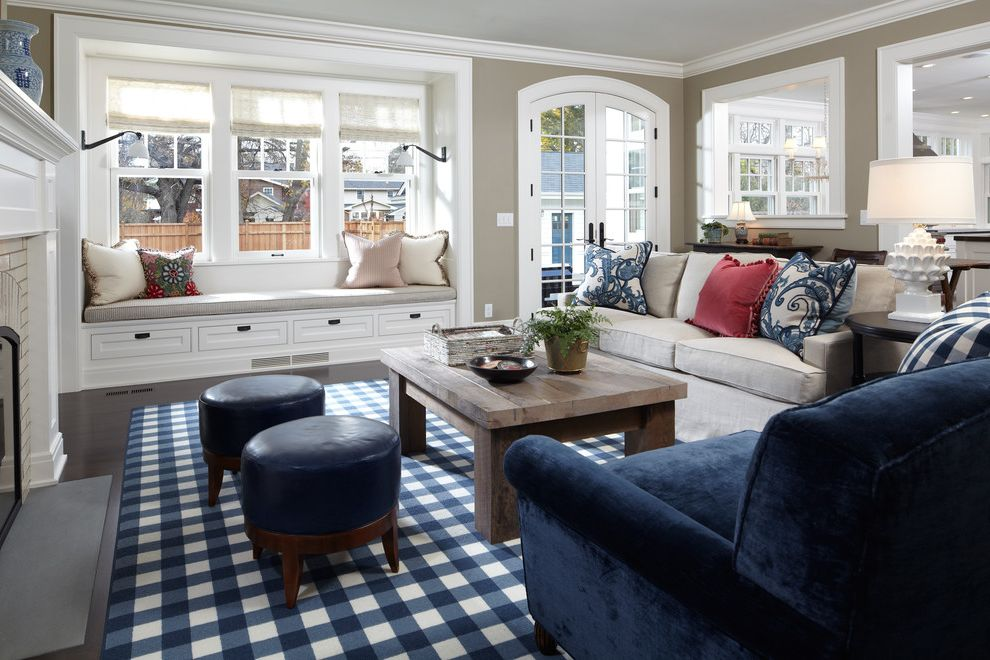 Blue and Tan Area Rugs with Traditional Family Room  and Area Rug Beige Couch Buffalo Plaid Rug Crown Molding Dark Floor Fireplace French Doors Round Footstool Tan Walls White Wood Window Seat Window Treatments Wood Coffee Table Wood Flooring Wood Trim