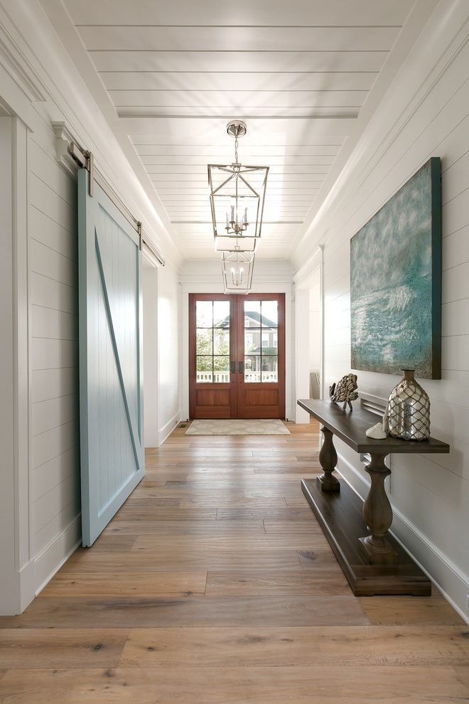 Blue Barn Sf with Beach Style Entry Also Abstract Art Beach Home Beadboard Ceiling Circa Lighting Coastal Home Contemporary Design Entry Foyer Restoration Hardware Ship Lap Sliding Barn Doors White Oak Wash Floors