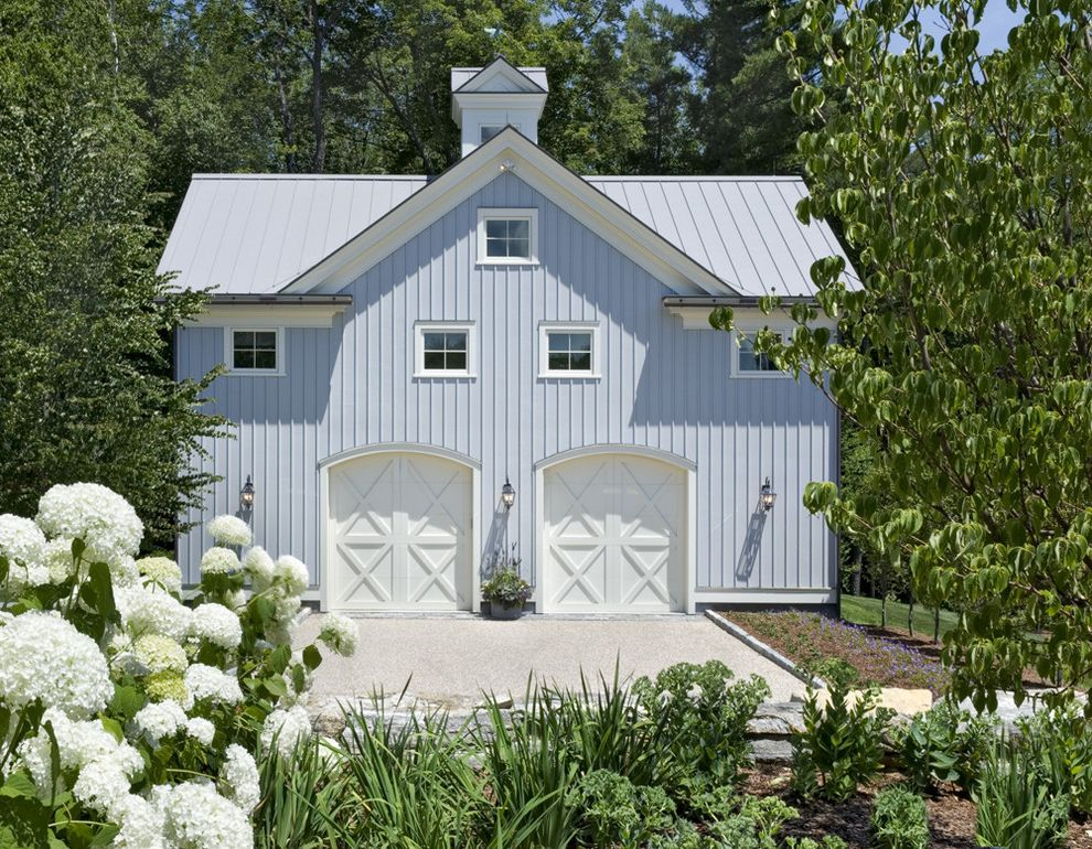 Blue Barn Sf with Farmhouse Shed  and Barn Barn Garage Doors Blue Vertical Siding Country Home Cupola Detached Garage Exterior Lighting Fixtures Farmhouse Garage Garden Guest House Landscaping Stone Pavers Traditional