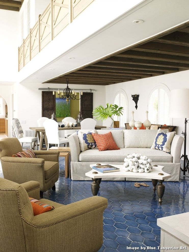 Blue Ceramic Floor Tile with Contemporary Living Room and Accent Colors Balcony Barn Doors Bold Colors Decorative Pillows Exposed Beams Great Room Nail Head Trim Open Floor Plan Throw Pillows Tile Flooring