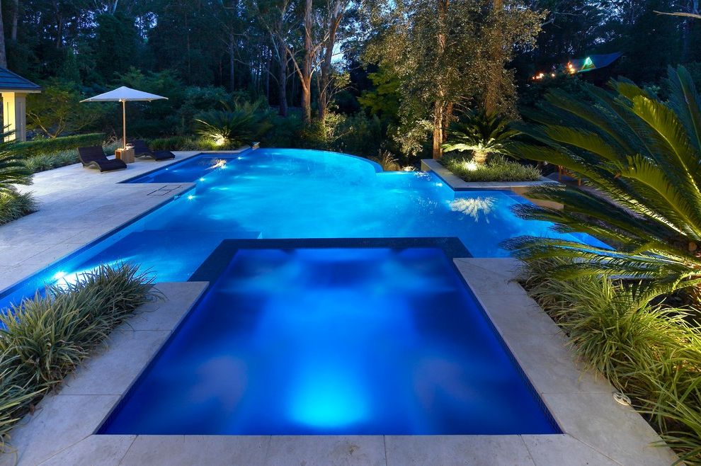 Blue Water Spa Raleigh Nc   Contemporary Pool  and Aquatic Backyard Hardscape Hedges Hot Tub Infinity Edge Pool Irregular Shape Pool Landscape Lounge Chairs Pavers Plants Pool Lighting Poolside Spa Trees Umbrella Water Feature