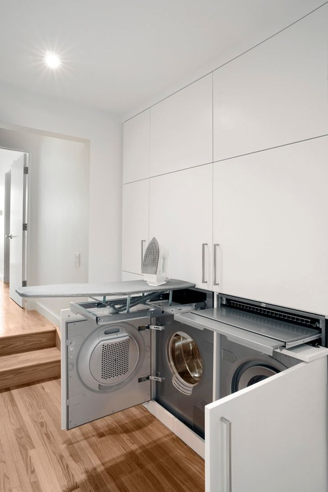 Boarding School Rooms   Contemporary Laundry Room  and Built in Cabinets Doorway Hall Hidden Washer and Dryer Ironing Boards Recessed Light Steps White Flat Panel Cabinets White Wall Wood Floor