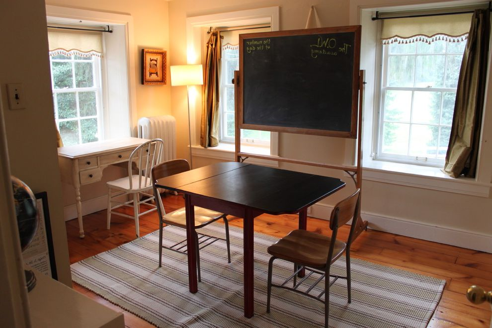 Boarding School Rooms   Farmhouse Home Office  and Baseboard Chalkboard Curtain Panel Desk Desk Chairs Fringe Radiator Roller Blind Spindle Chair Striped Area Rug White Painted Trim Wide Plank Wood Floor