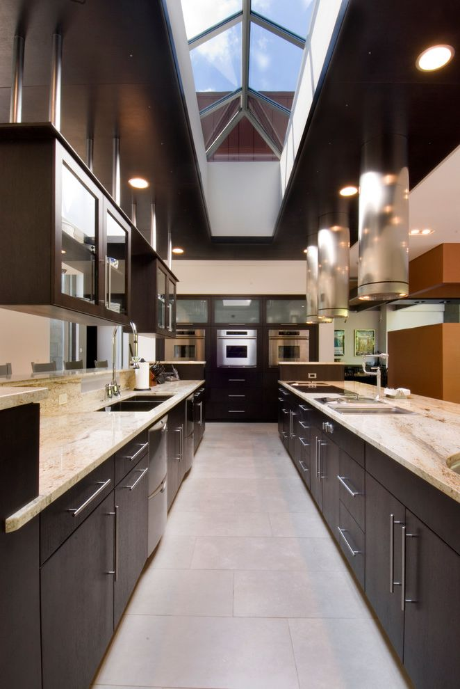 Bob Wallace Appliance with Contemporary Kitchen  and Cylinder Hood Dark Stained Wood Cabinets Flush Work Galley Kitchen Hanging Cabinets Recessed Lights Sky Light Stainless Steel Appliances Suspended Cabinets Tile Floor
