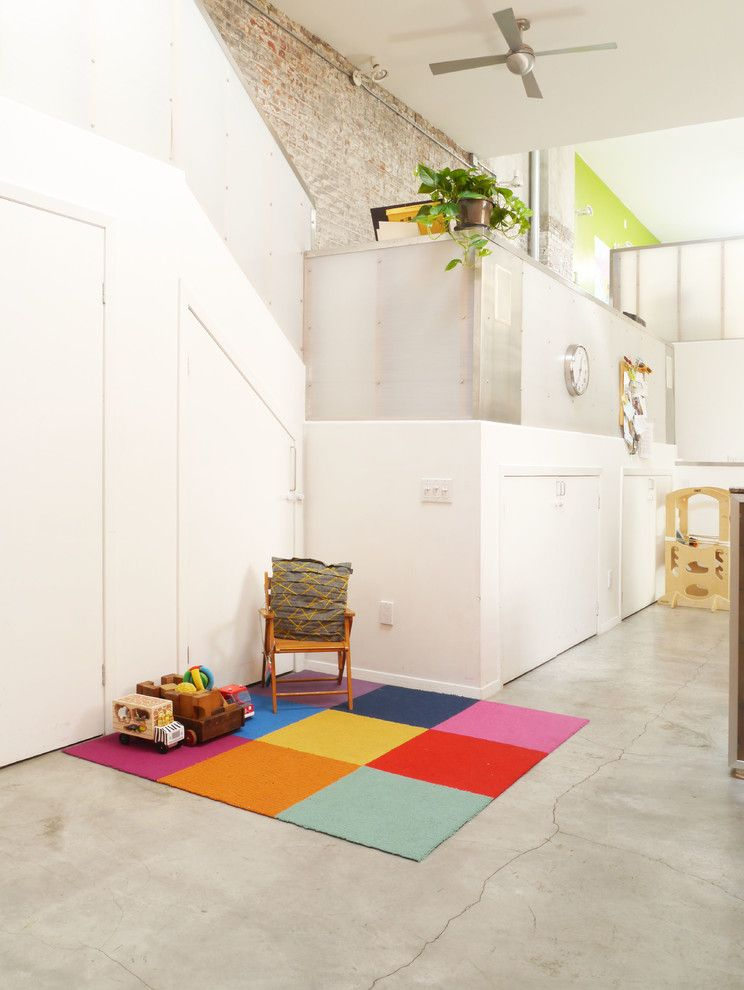 Body Shop of Barrington with Eclectic Living Room Also Brick Wall Ceiling Fan Colorful Rug Exposed Brick High Ceiling Industrial Kids Play Area My Houzz