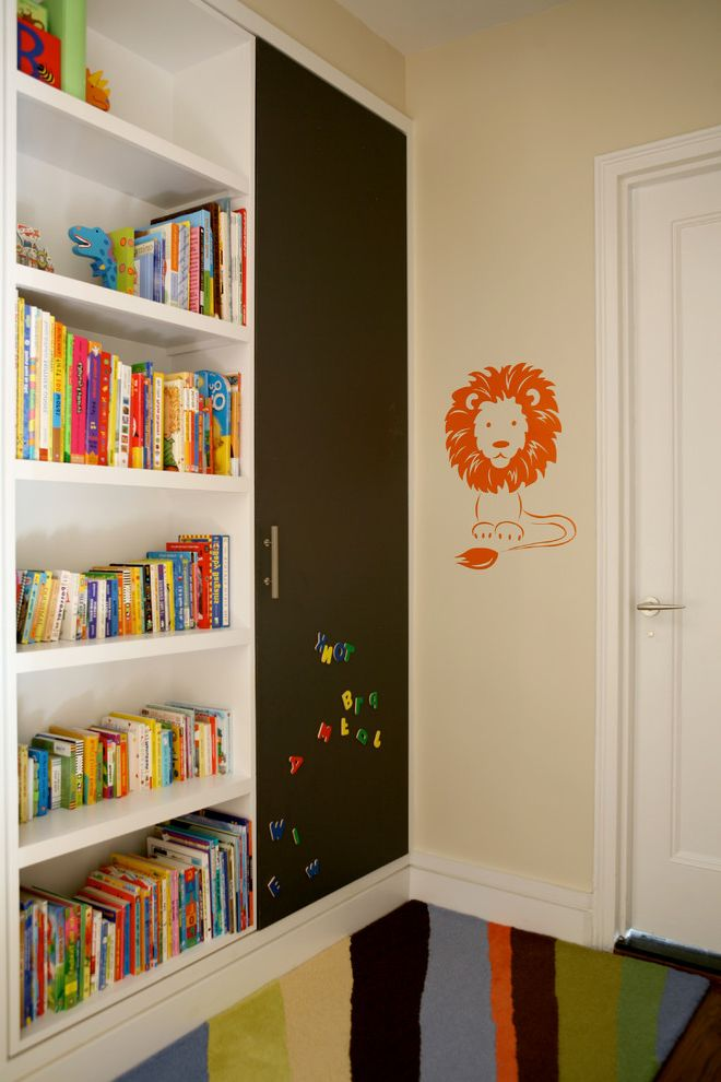 Bookcase for Kids Room   Transitional Kids  and Beige Wall Built in Bookcase Built in Bookshelf Kids Books Lion Wall Decal Magnet Door Magnets Orange Decal Orange Wall Decal Striped Rug White Door White Molding White Trim