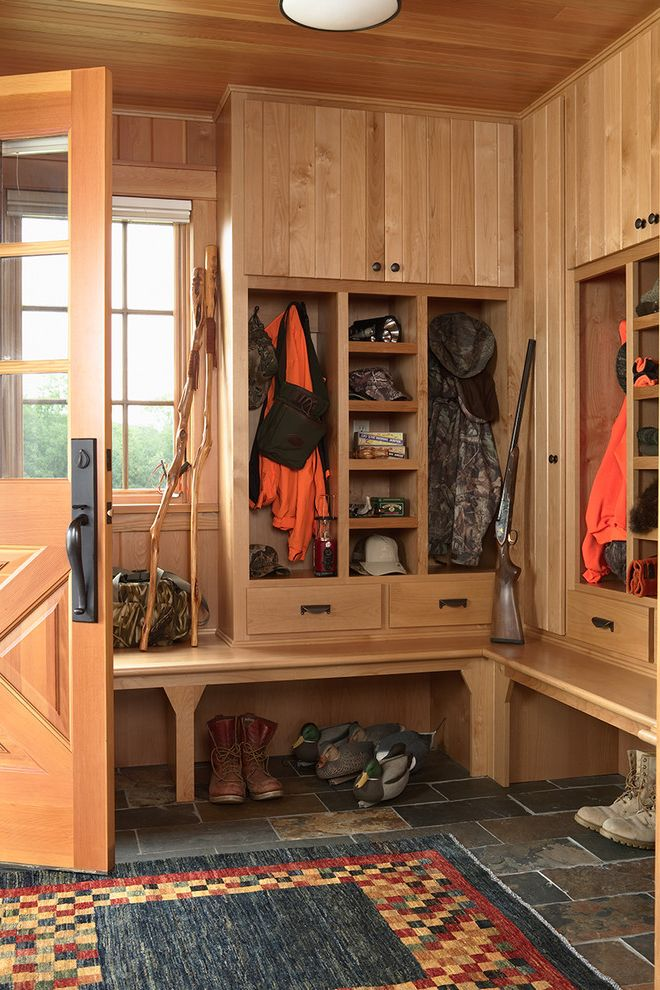 Boot Ranch Golf   Rustic Entry  and Bead Board Boots Built in Bench Seat Cubbies Entry Rug Gun Hunting Gear Shoe Storage Slate Tile Floor Walking Sticks Wood Cabinet Doors Wood Ceiling Wood Paneling