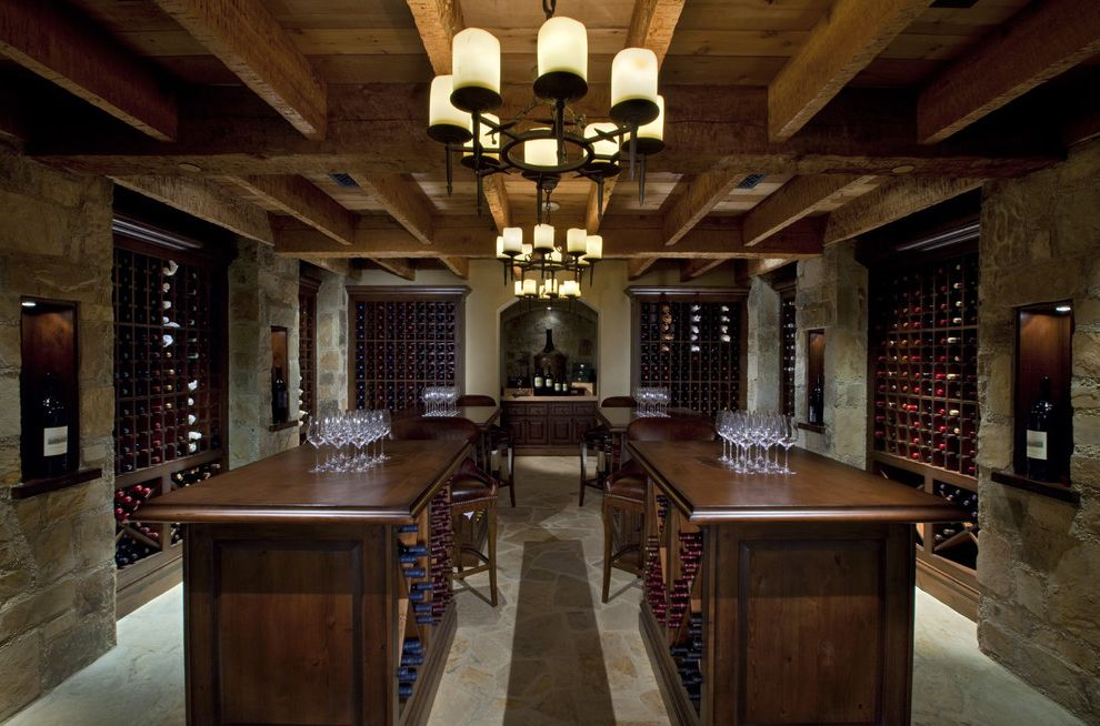 Boot Ranch Golf   Rustic Wine Cellar  and Bar Stool Beige Wall Chandelier Dark Wood Cabinets Dark Wood Countertop Stone Floor Stone Wall Tasting Room Wine Wine Cellar Wine Rack Wine Storage Wine Tasting Room Wood Ceiling Beams