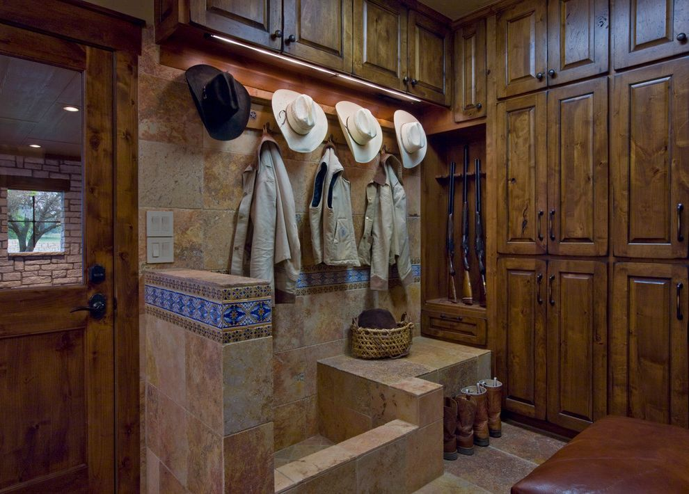 Boot Ranch Golf with Rustic Entry  and Brown Leather Coat Rack Cowboy Hats Knotty Pine Mud Room Painted Tile Raised Panel Woodwork Stone Tile Stonework