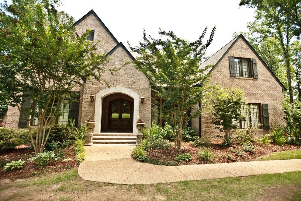 Boral Siding   Traditional Exterior Also Aggregate Path Arched Entry Brick Facade Covered Entry Dark Trim Double Doors French Windows Gable Roof Landscaping Lawn Limestone Shutters Urns