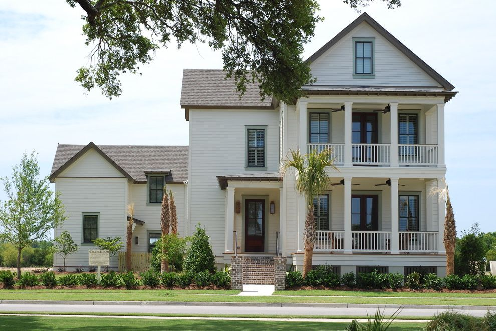 Boral Siding   Traditional Exterior Also Balcony Columns Entrance Entry Front Door Grass Handrail Lawn Neutral Colors Outdoor Lighting Path Plantation Porch Turf Walkway White Wood Wood Railing Wood Siding Wood Trim