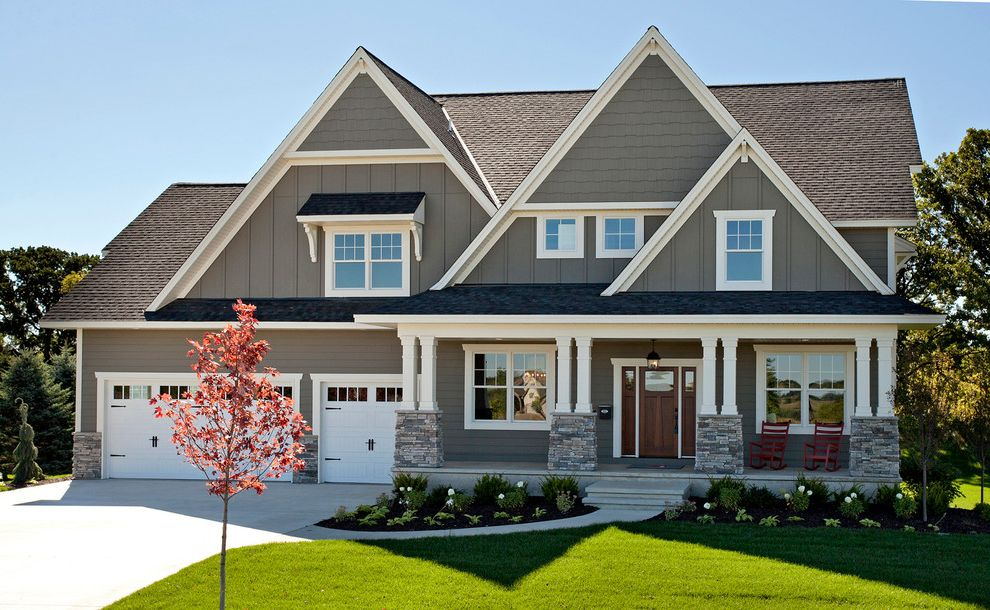 Boral Siding   Traditional Exterior  and Awning Board and Batten Columns Driveway Gable Roof Gray Exterior Rocking Chairs Shingles Sidelites Stonework Three Car Garage White Casing Wood Entry Door