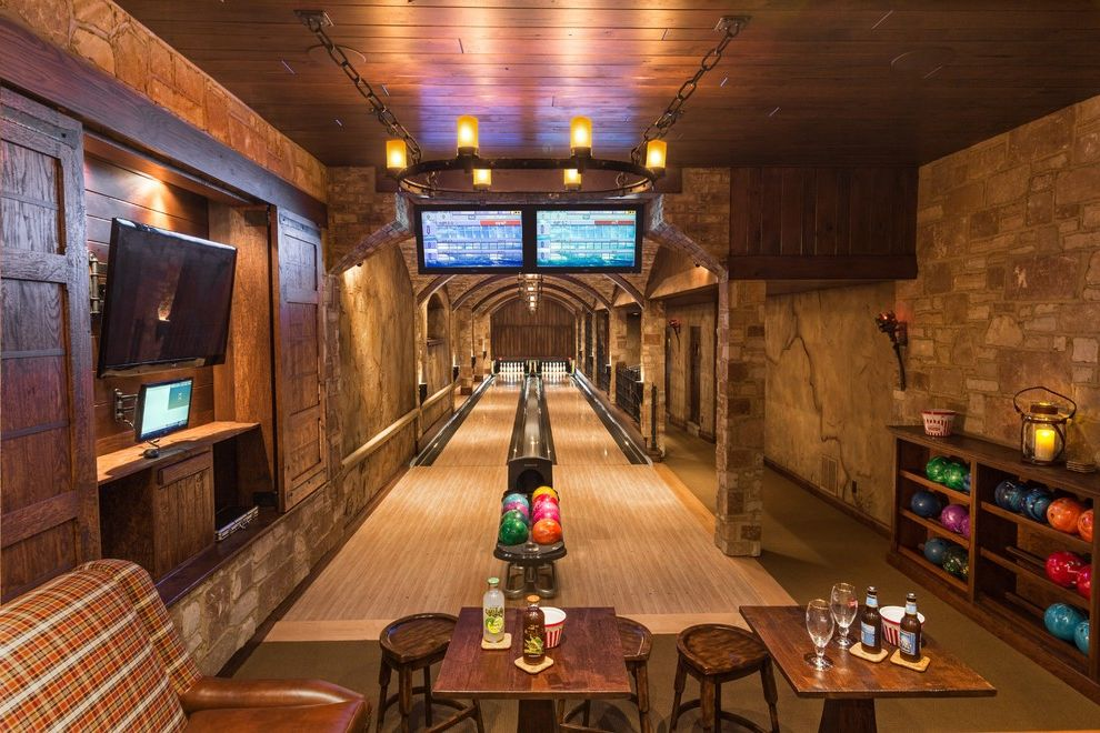 Bowling Alley Nyc   Rustic Basement Also Bowling Alley Dark Wood Dungeon Game Room Home Bar Home Bowling Lane Home Lounge Loggia Sliding Doors Stone Two Lane Bowling Alley Wall Finishes Wall Mounted Tv Wood Ceiling