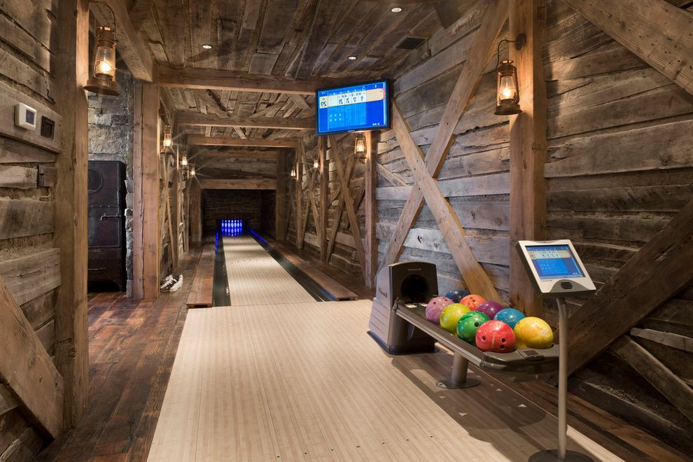 Bowling Alley Nyc   Rustic Family Room Also Bowling Alley Fun Game Room Lantern Sconce Rustic Wood Wood Paneling X Pattern