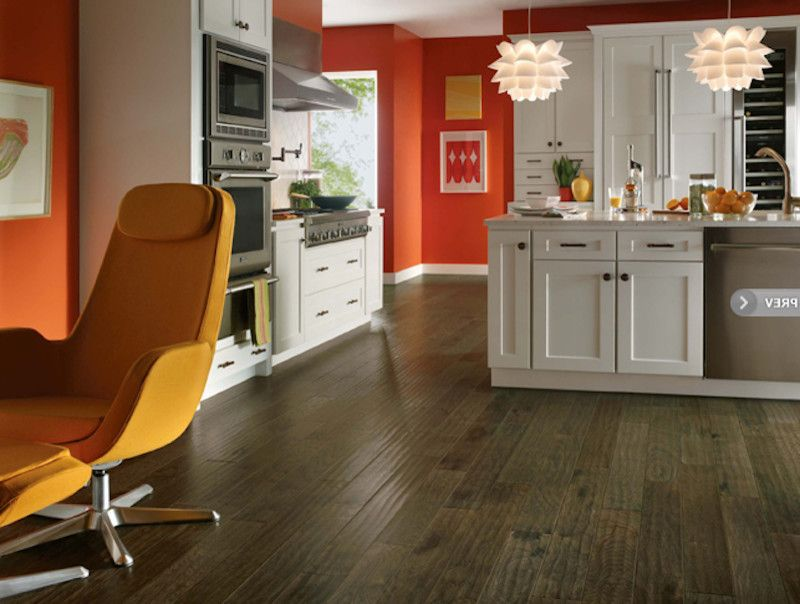 Boyles Flooring    Spaces  and Dark Wooden Floor Modern Light Fixture Red Accents Stainless Steel Fixtures White Cabinets
