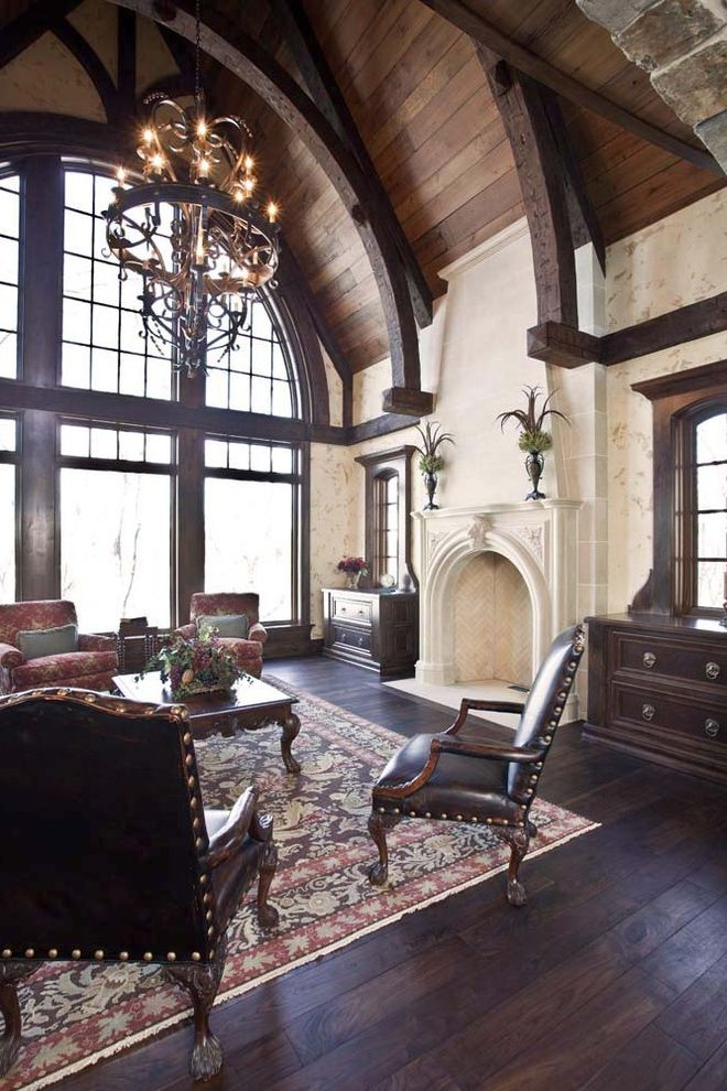 Boyles Flooring   Traditional Living Room Also Arched Window Built Ins Chandelier Coffee Table Exposed Beams Fireplace Leather Chairs Mantle Nail Head Trim Rug Vaulted Ceiling Wood Ceiling Wood Flooring Wood Window Trim