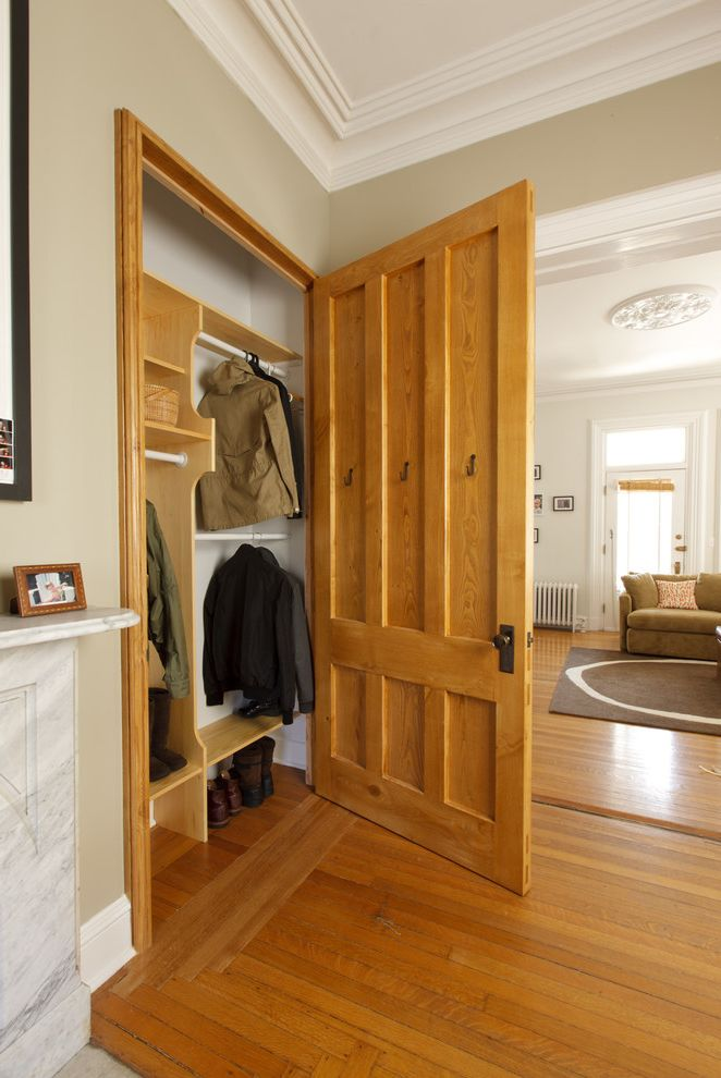 Brass Closet Rod with Eclectic Closet Also Closet Interior Closet Rods Coat Closet Coat Storage Coving Crown Molding Entry Closet Shoe Storage Six Panel Door Wood Floor Transition