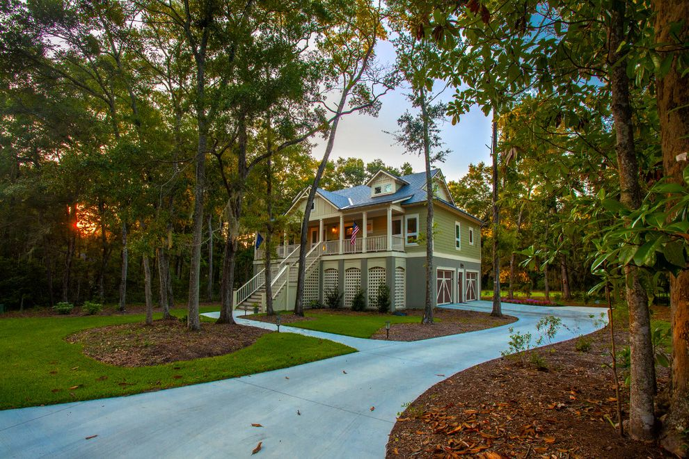 Brickman Landscaping   Traditional Exterior Also Concrete Driveway Covered Porch Dormer Window Exterior Stairs Green Siding Landscape Design Landscaping Lattic Outdoor Lighting Pathway Shingle Roof Trees Two Car Garage Walkway
