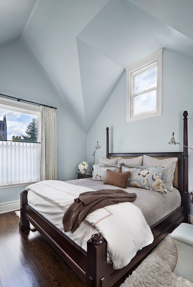 Broadstone Hyde Park   Transitional Bedroom  and Baseboards Blue Walls Brown Sheets Cathedral Ceiling Hotel Bedding Reading Lamp Sloped Ceiling Vaulted Ceiling White Bedding White Trim Wood Bed Wood Floors