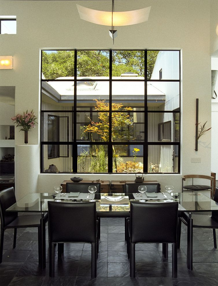 Bronze Vinyl Windows   Contemporary Dining Room Also Black and White Ceiling Lighting Chandelier Courtyard Dark Floor Floral Arrangement Glass Dining Table Minimal Neutral Colors Sconce Table Setting Tile Flooring Wall Art Wall Decor