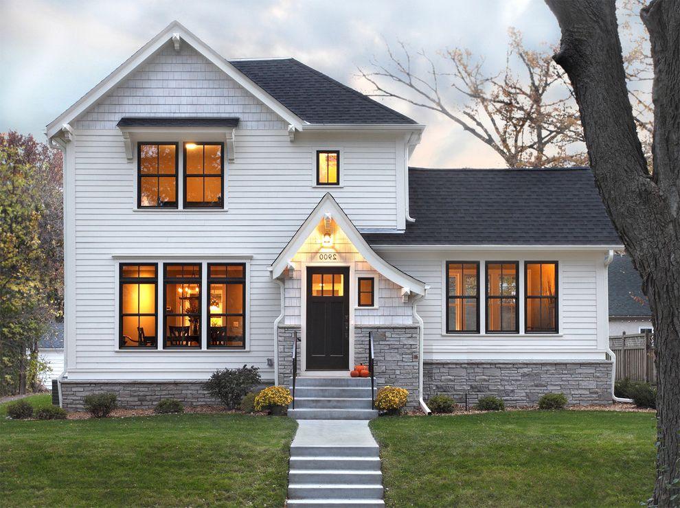 Bronze Vinyl Windows with Traditional Exterior  and Dark Trim Dutch Gable Roof Exterior Lighting Fiber Cement Hardie Horizontal Siding Landscape Lawn Shrubs Steps Stone