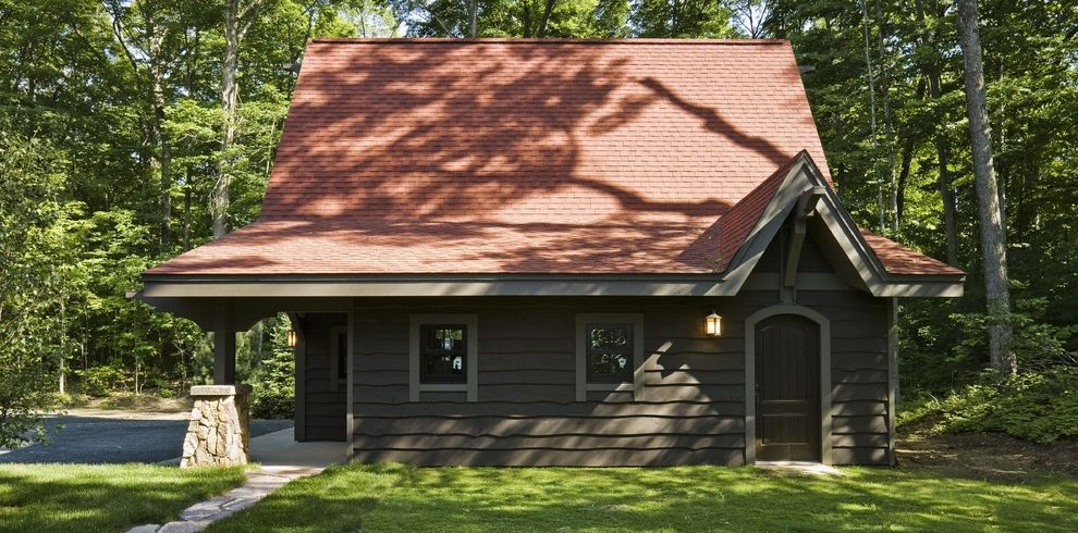 Brown Boys Roofing with Rustic Exterior Also Arched Doorway Column Combination Roof Covered Entry Driveway Eaves Forest Grass Lawn Post Red Roof Shingle Siding Stone Wall Sconce