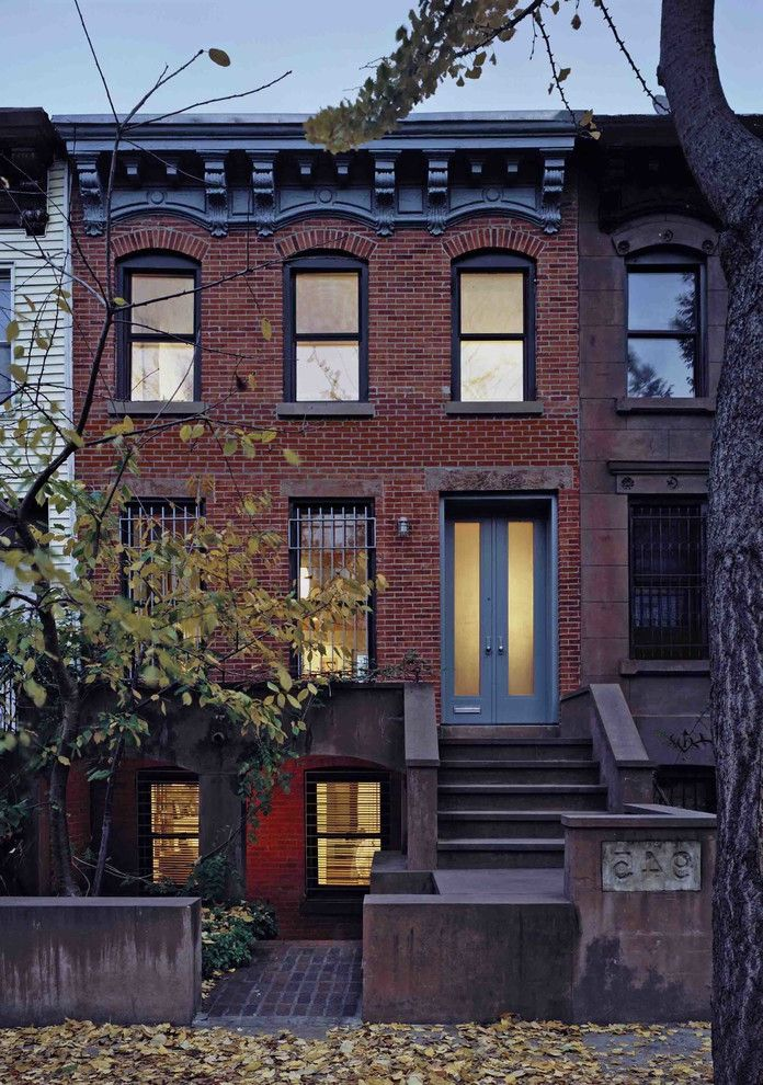 Brownstone Properties with Transitional Exterior  and Arched Windows Brick Facade City Living Concrete Double Doors Front Doors Townhouse