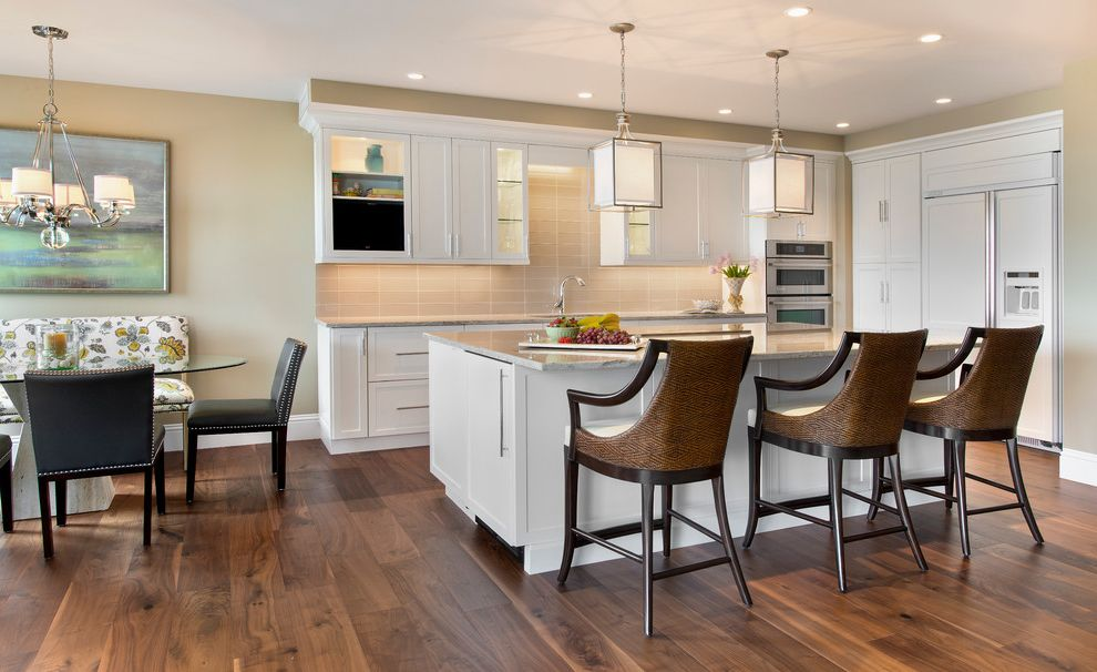 Builders Supply Omaha   Transitional Kitchen Also Galley Kitchen Glass Dining Table Kitchen Island Seating Mix and Match Dining Chairs Pendant Lighting Recessed Lighting Shaker Style White Cabinets Wood Floors