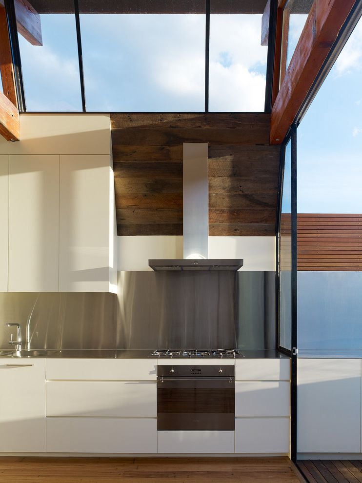 Burns Pest Elimination with Industrial Kitchen  and Modern Kitchen Skylight Stainless Steel Stainless Steel Backsplash Vaulted Ceiling White Kitchen Wood Ceiling Wood Floor