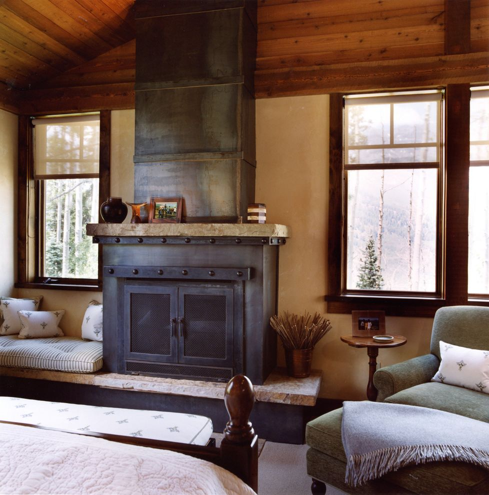 Burns Pest Elimination with Rustic Bedroom Also Armchair Cabin Faux Finish Fireplace Fireplace Hearth Fireplace Mantel Master Bedroom Ottoman Raised Hearth Fireplace Roller Blinds Rustic Sloped Ceiling Window Seat Wood Ceiling