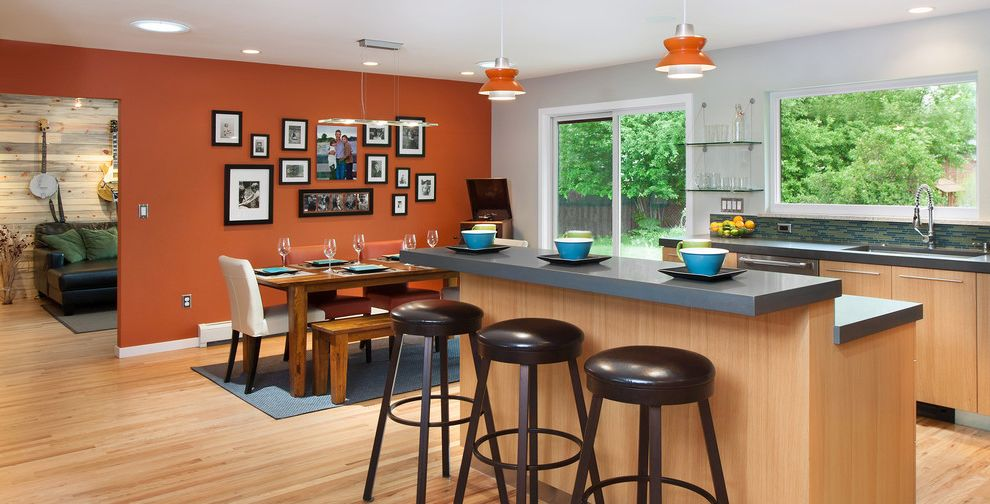 Burnt Orange Accent Chair with Contemporary Kitchen  and Bar Stools Black Barstools Dining Gray Countertops Kitchen Bar Open Kitchen Orange Orange Accents Orange Lights Pendant Light Picture Collage Table Wood Floor
