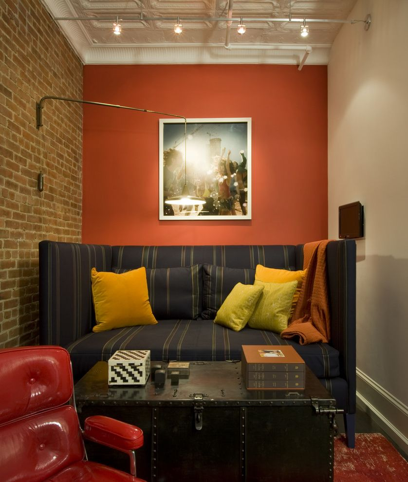 Burnt Orange Accent Chair with Industrial Family Room Also Accent Wall Brick Wall Daybed Fond Wall High Side Sofa Industrial Ceiling Orange Paint Orange Wall Spot Lights Swivel Chair Trunk Yellow Pillows
