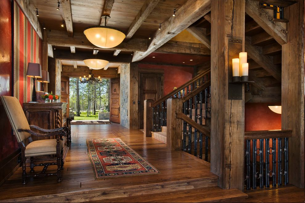 Cabin Wall Sconces with Rustic Entry  and Bowl Lights Candles Commode Console Double Doors Entry Hardwood Floor Lighting Persian Rug Runner Red Walls Rustic Staircase Rustic Wood Stairs Wood Beams Wood Floor Wood Posts