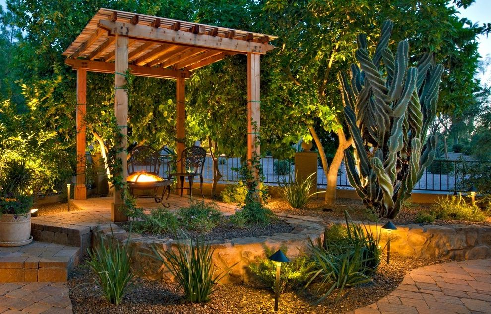 Cactus Forty 2   Mediterranean Patio  and Cactus Cobblestone Patio Courtyard Fire Pit Firepit Fountain Gardens Landscape Mediterranean Outdoor Lighting Outdoor Living Overhang Palnter Patio Pergola Plants Sculptural Trees Wrought Iron Furniture