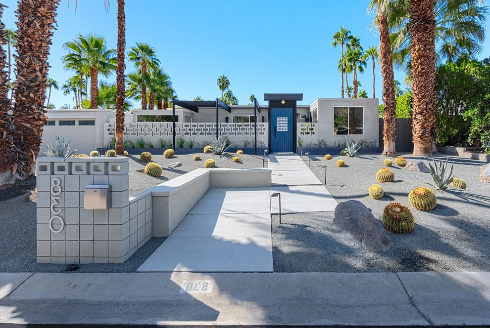 Cactus Forty 2 with Midcentury Exterior  and Address Numbers Blue Door Cactus Entry Gate Flat Rooftop Palm Springs Palm Trees Pavers Retainer Wall Xeriscape