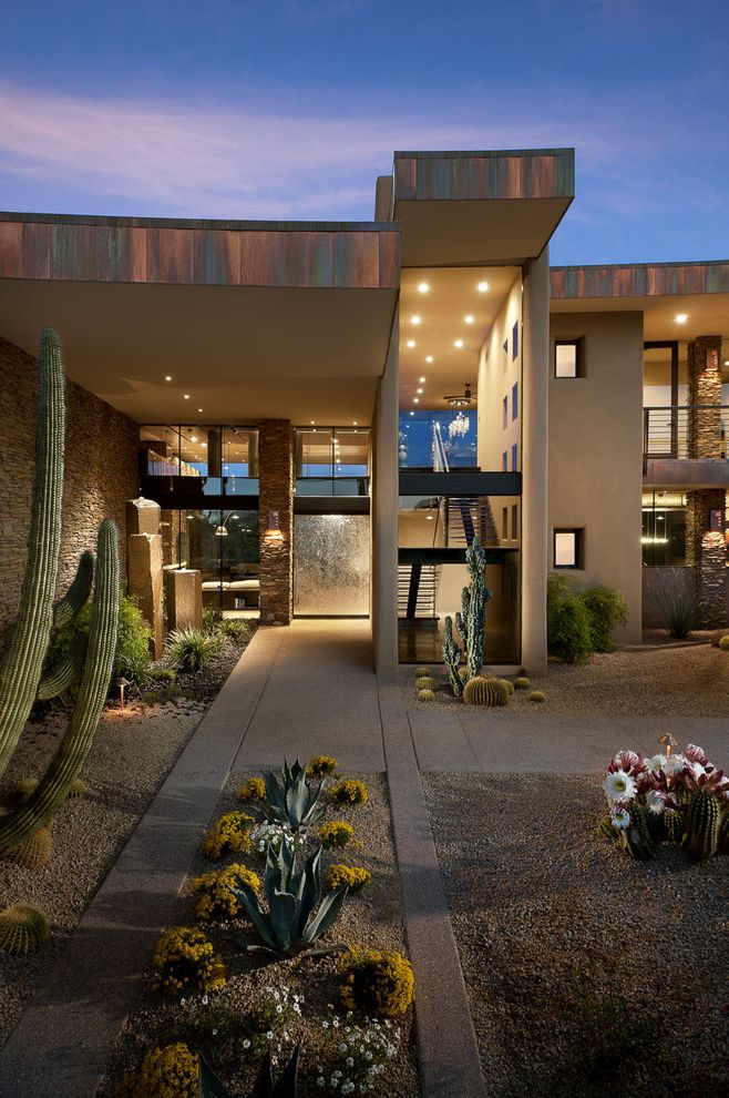 Cactus Forty 2 with Southwestern Exterior Also Arid Landscape Concrete Paving Desert Entrance Entry Flat Roof Front Door Geometric Geometry Glass Wall Gravel Metal Trim Night Outdoor Lighting Oxidized Planter Roof Line Roof Overhang Stone Wall Transom