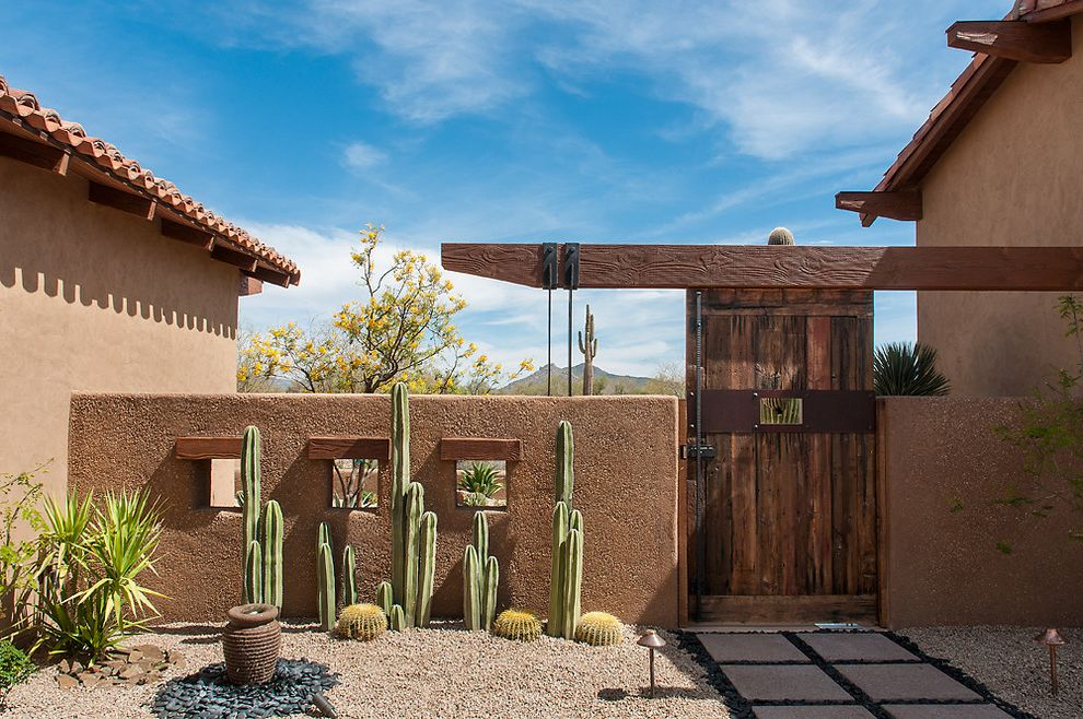 Cactus Forty 2 with Southwestern Landscape Also Beige Stucco Exterior Beige Stucco Siding Cactus Concrete Pathway Concrete Pavers Concrete Walkway Gravel Gravel Landscape Rustic Wood Door Rustic Wood Gate Stucco Wall Terracotta Tile Roof Wood Beam