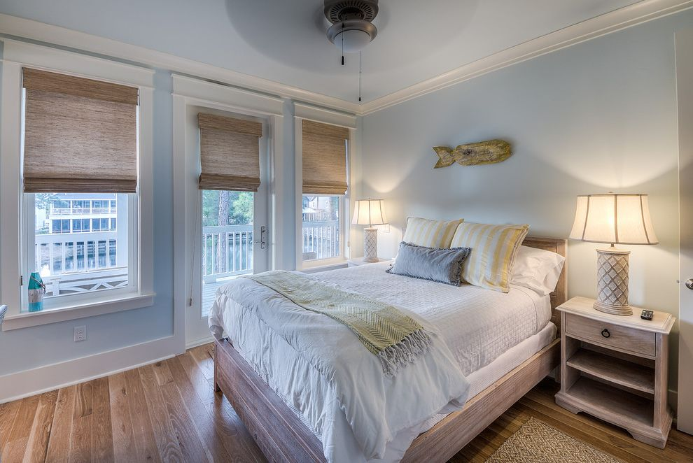Caldera Springs Rentals   Beach Style Bedroom Also Beach Furniture Crown Moulding Gray Pillow Light Blue Walls Roman Shades Symmetry White Quilt White Sheets Wood Floors Yellow Pillows