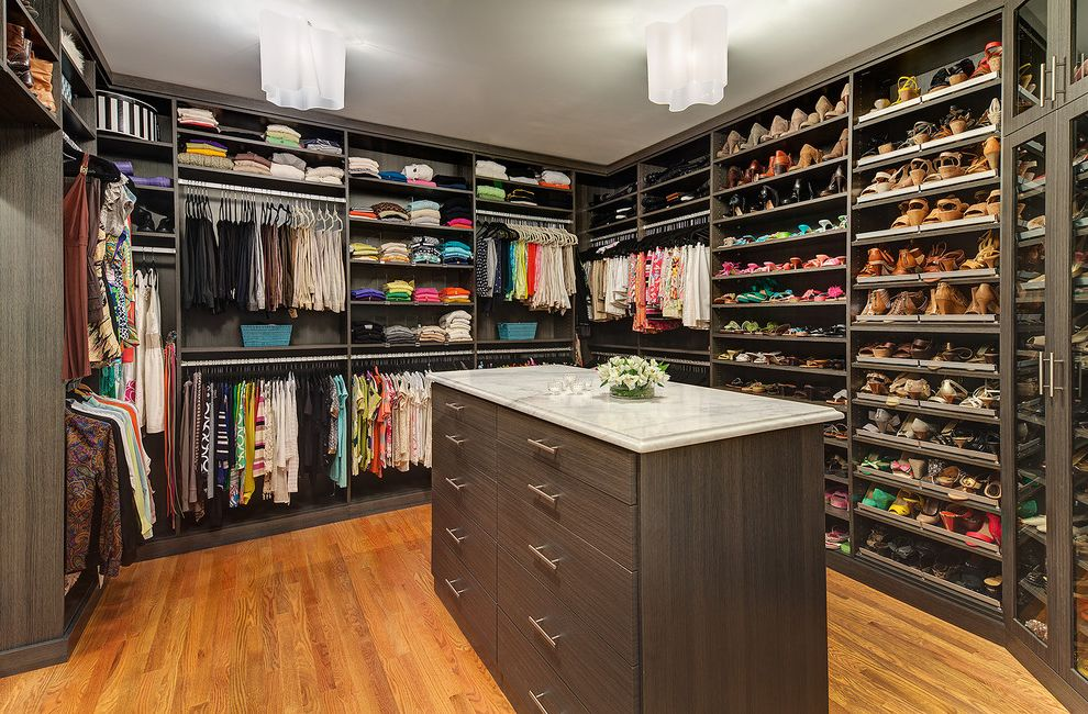California Closets Seattle with Contemporary Closet Also Ceiling Lights Closet Island Clothes Rods Dark Stained Wood Dresser Flat Panel Drawers Marble Counter Shoe Storage Walk in Closet Wood Floor