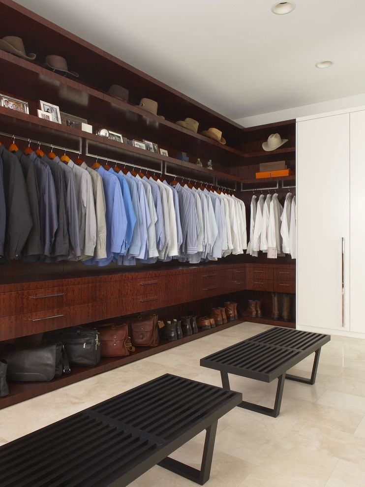 California Closets Seattle with Contemporary Closet  and Dark Stained Wood Hats Mens Closet Tile Floor Walk in Closet White Flush Cabinets Wood Benches