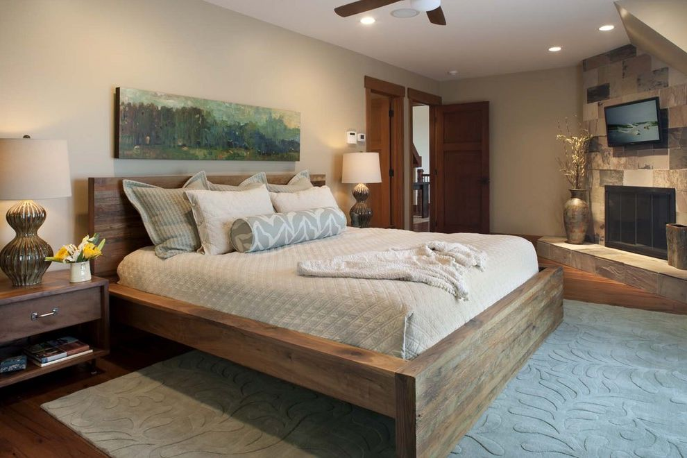 California King Bed Frame and Headboard with Contemporary Bedroom  and Area Rug Art Work Beige Ceiling Fan Corner Fireplace Gray Low Profile Bed Night Stand Pilows Quilt Rustic Wood Table Lamp Wood Floor