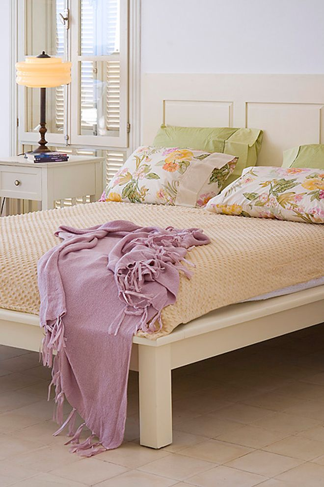 California King Bed Frame and Headboard with Shabby Chic Style Bedroom Also Bedside Table Floral Pillows Nightstand Platform Bed Table Lamp Tile Flooring Window Shutters Window Treatments Wood Bed Wood Headboard Wood Shutters