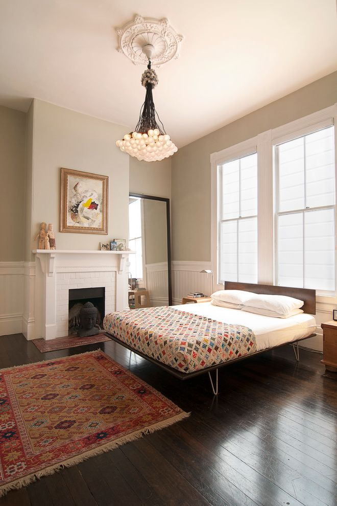 California King Quilts   Victorian Bedroom  and Area Rug Beadboard Ceiling Medallion Cluster Chandelier Fireplace Gray Walls Hairpin Legs Leaning Mirror Oriental Tug Patchwork Quilt Victorian Wainscoting White Brick White Trim Wood Floors