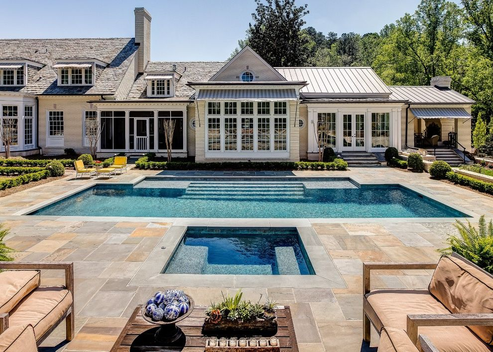 California Pools & Spas with Traditional Pool  and Beige Siding Dormer Windows Elements Landscape Outdoor Seating Pool and Spa Desgn Shingle Roof Striped Awning