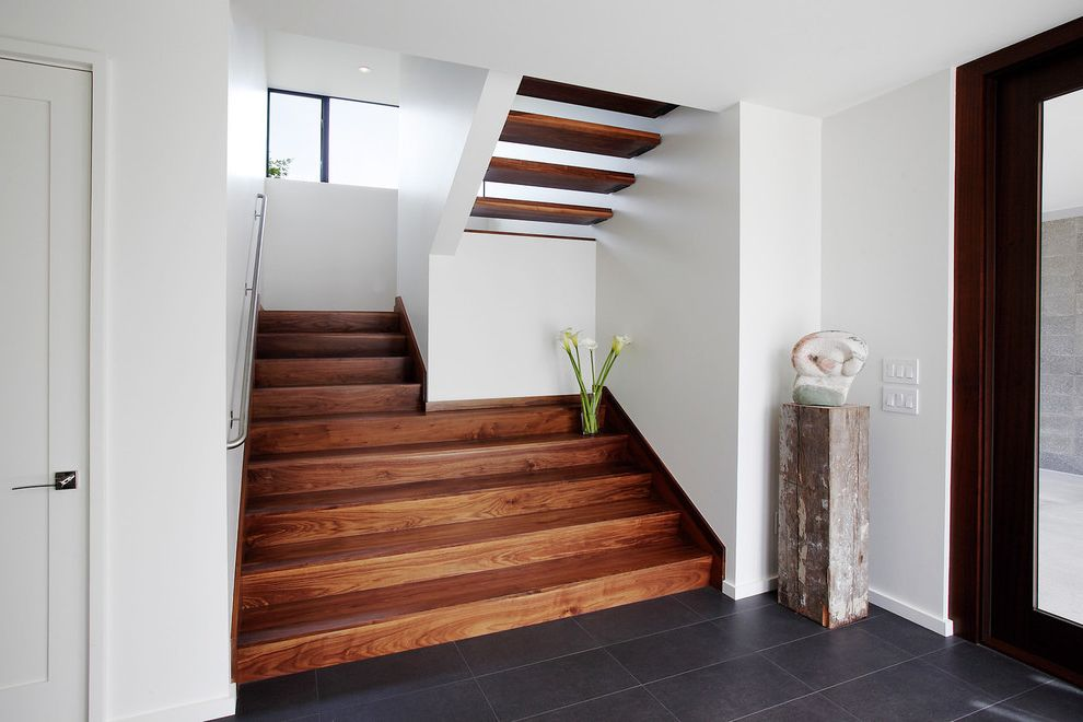 Callas Contractors   Contemporary Staircase  and Black Floor Tile Entry Floating Stairs Glass Door No Risers Open Stairs Stairs Walnut White Wall