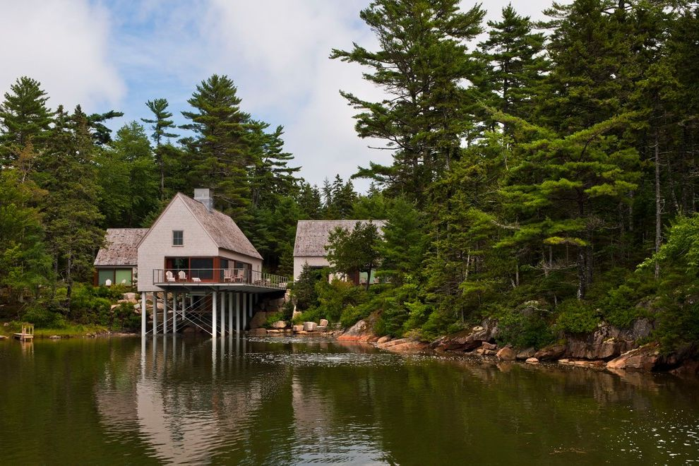 Camp Lejeune Housing with Transitional Exterior  and a Frame Chimney Cottage Dock Maine Natural Landscape New England Pond Pond House Secluded Shingled Cottage Stilted House Trees Waterfront Window Wall