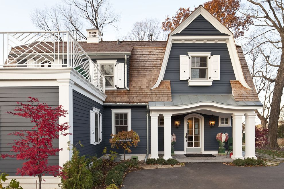 Can Vinyl Siding Be Painted with Traditional Exterior and Arched Doorway Asphalt Columns Cupola Eyebrow Roof Gray Landscaping Lap Siding Metal Roof Posts Railing Roof Deck Shingle Roof Shutters White Painted Trim