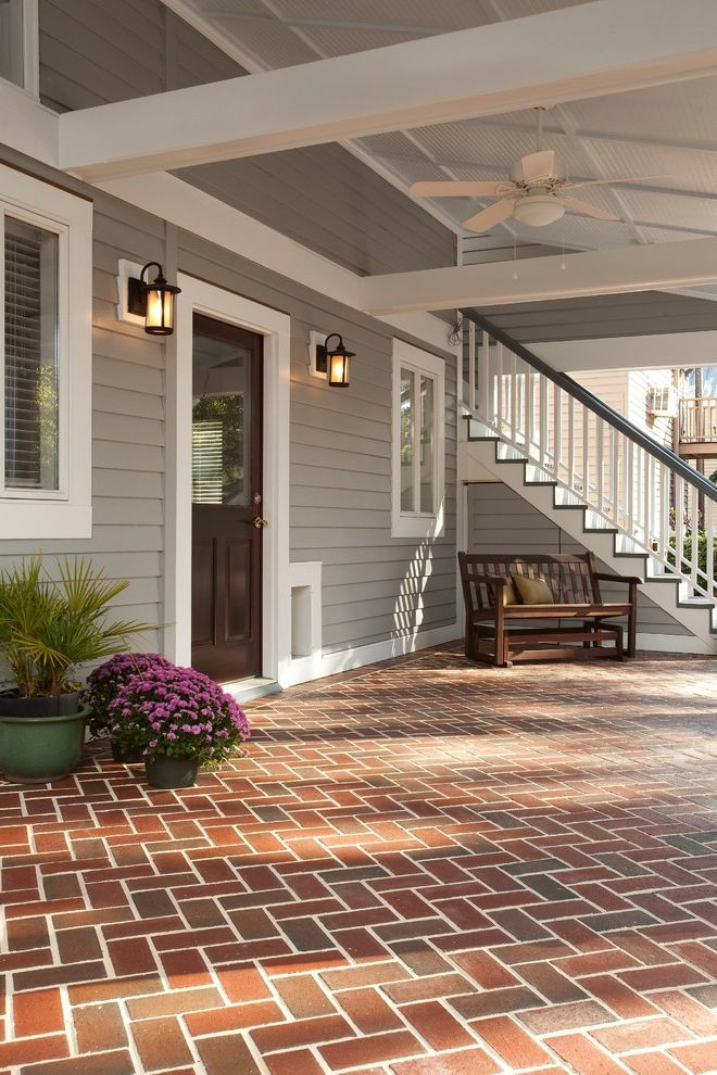 Can Vinyl Siding Be Painted with Traditional Porch and Brick Paving Ceiling Fan Container Plants Herring Bone Brick Pattern Lanterns Porch Potted Plants White Trim Wood Siding